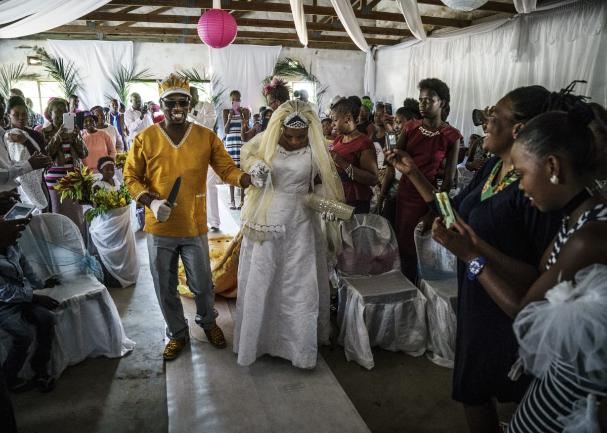 Jonas Bendiksen, Moses and Angel walking up the aisle, South Africa, 2016