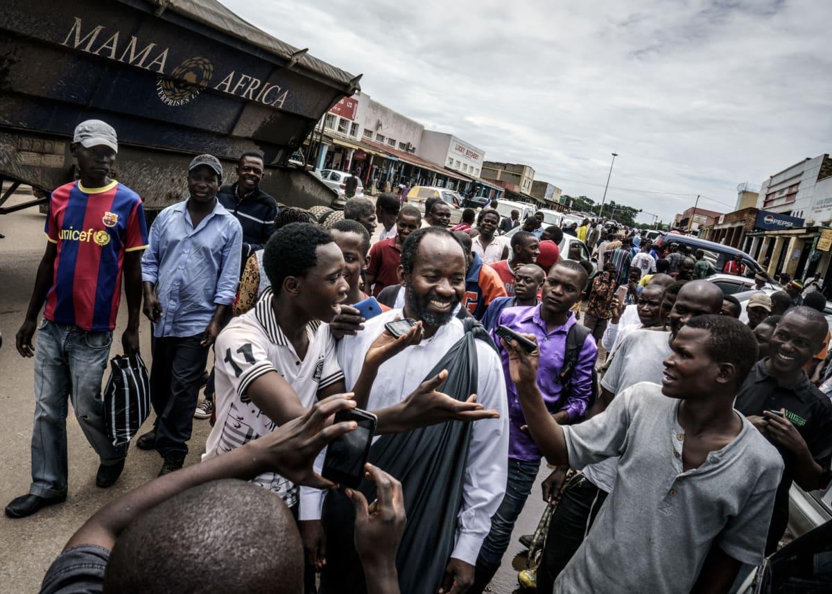 Jonas Bendiksen, Jesus of Kitwe preaching in a marketplace, Zambia, 2016