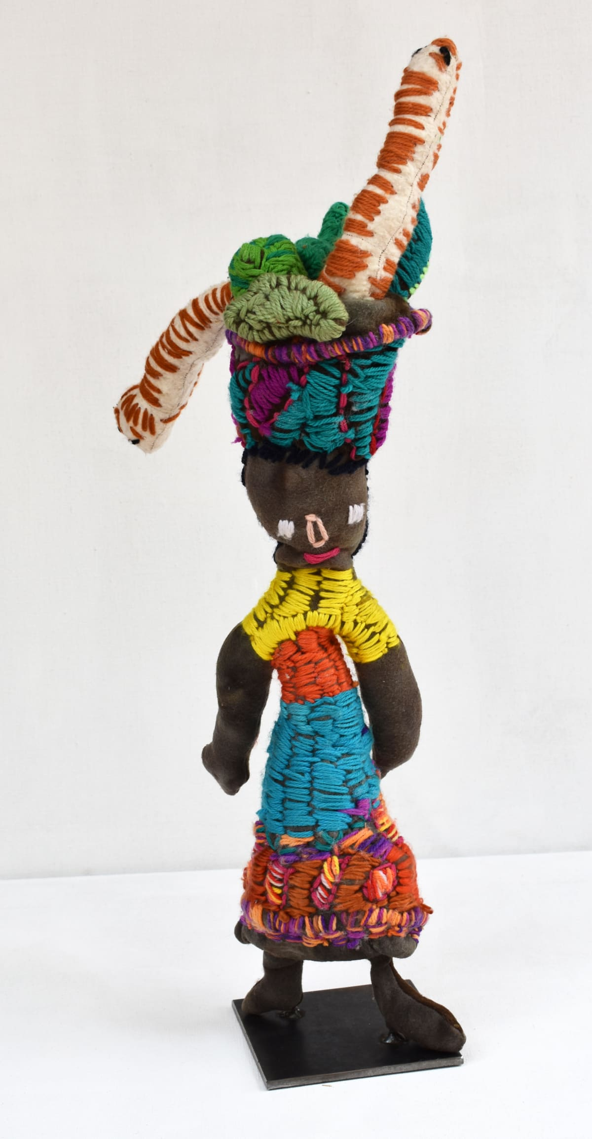 Trudy Inkamala Lady With Bush Tucker on Her Head mixed media 70 x 33 x 10 cm