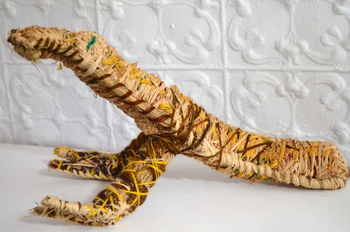 Tjariya (Nungalka) Stanley Eagle raffia and minarri (greybeard) grass and wool 24 x 44 x 25 cm