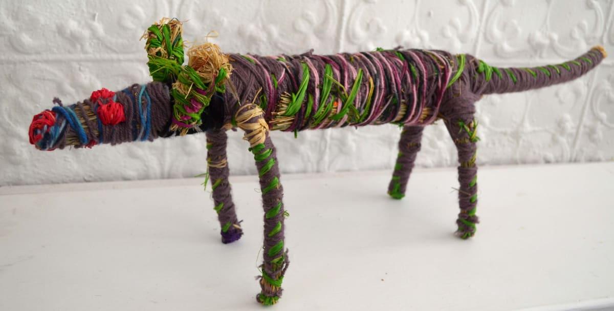 Pauline Minmila Wangin Tinka (lizard) raffia and minarri (greybeard) grass and wool 20 x 76 x 15 cm