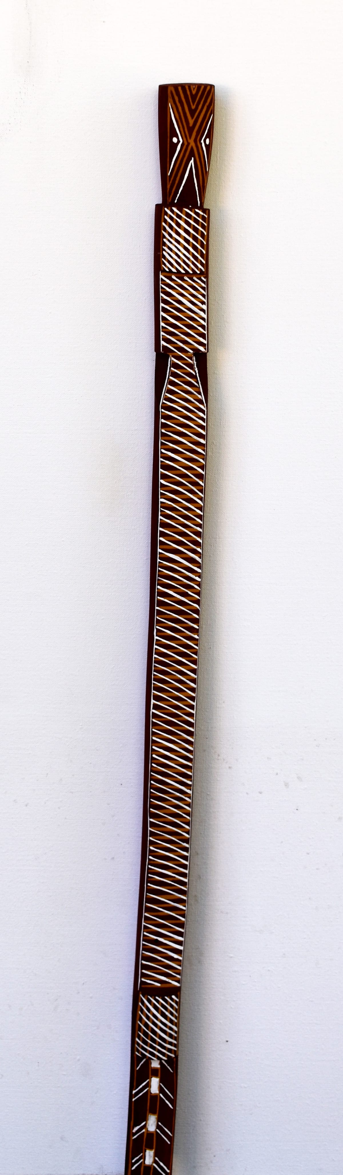 Joy Garlbin Djomi, 2018 Carved Wood & Ochre 94 x 4 x 4 cm