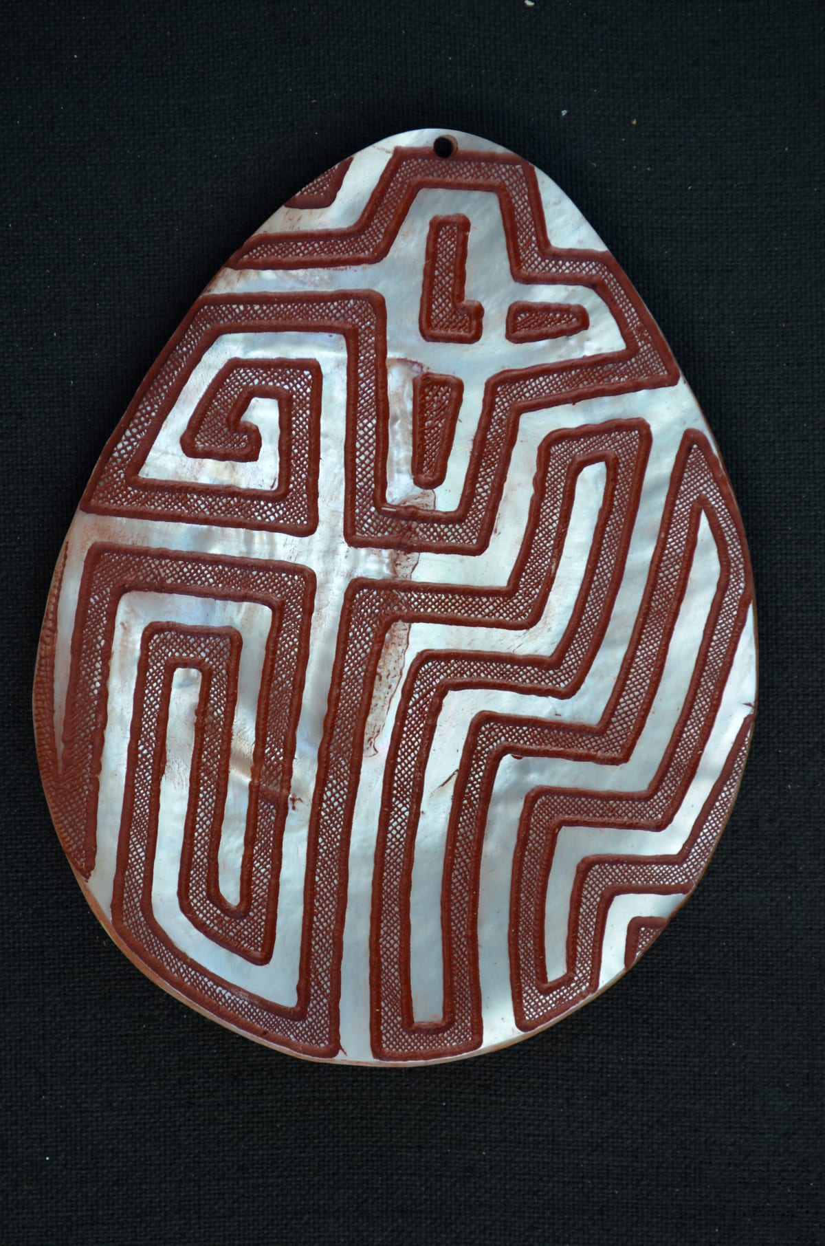 Sebastian Arrow Riji carved pearl shell & red ochre 17 x 13 cm