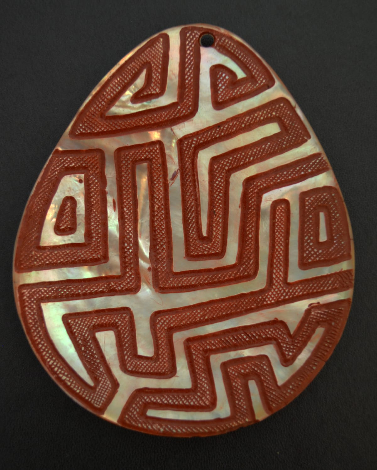 Sebastian Arrow Untitled carved pearl shell & red ochre 13 x 11 cm