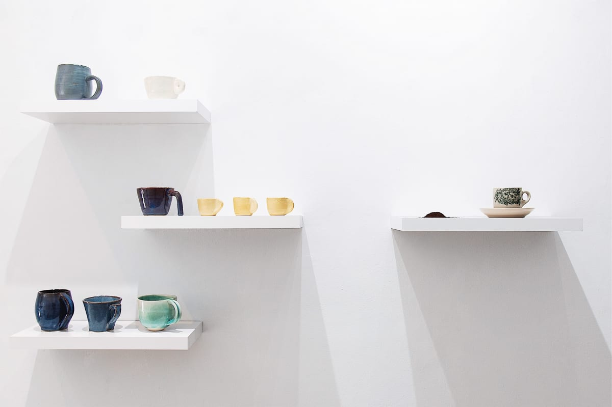 Si Jie Loo Privilege of Taste, 2019 Floating shelves, ceramic cups and coffee powder 31 × 60 × 6 in 78.7 × 152.4 × 15.2 cm