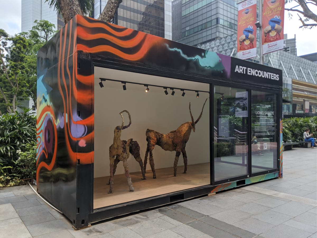 Lionel Sabatte and his completed Prehistoric Concrete Goats on Orchard Road