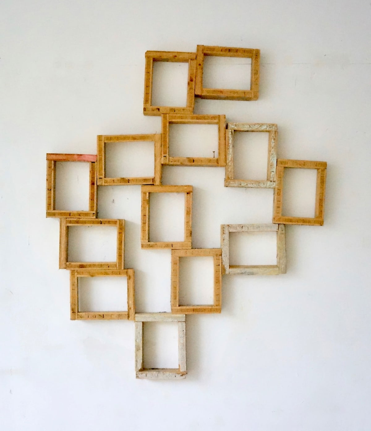 wood sculpture like frames hanging as a wallpiece, artwork by ernst koslitsch titeled selfportrait as boxes