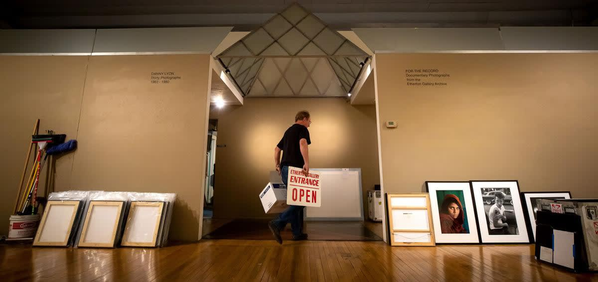 Terry Etherton, owner of Etherton Gallery, works on moving items out of his old gallery location at 135 S. Sixth Ave. After 33 years, Etherton is moving his gallery to a new location in Barrio Viejo. Photograph by Rebecca Sasnett, Arizona Daily Star