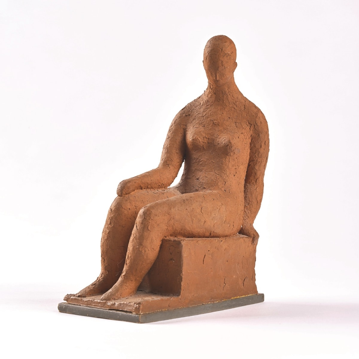 Hannah Frank Seated Figure signed H Levy; signed and titled in pen to base clay 9 3/4 x 4 x 6 1/2 inches