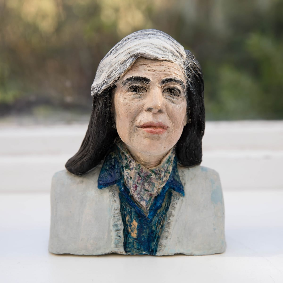 Nicole Farhi Susan Sontag ciment fondu and acrylic; hand-painted bronze casts available to purchase 18 x 15 x 7 cm edition of 7 + 3 APs