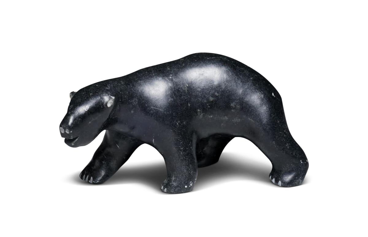 LOT 31 ANDY MAMGARK (1930-1997) ARVIAT (ESKIMO POINT) Traversing Polar Bear, c. 1990 stone, 2 1/4 x 5 3/4 x 2 in (5.7 x 14.6 x 5.1 cm) ESTIMATE: $500 — $800