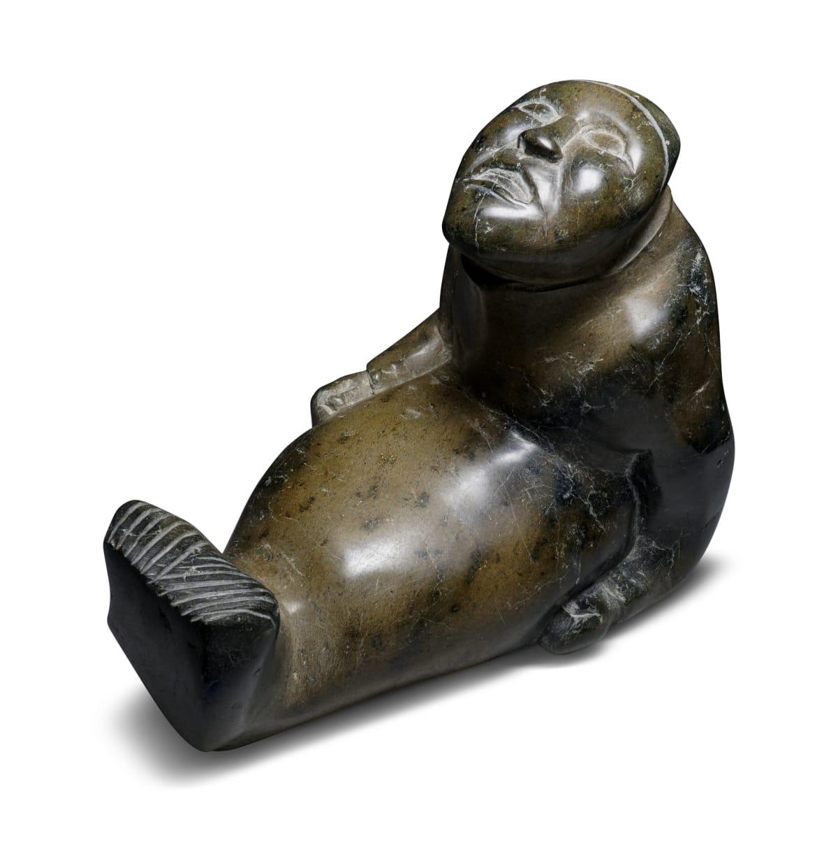 LOT 27 Possibly: TAYARAQ TUNNILLIE (1934-2015) KINNGAIT (CAPE DORSET) Shaman Seal Transformation stone, 12 3/4 x 9 x 14 in (32.4 x 22.9 x 35.6 cm) ESTIMATE: $2,000 — $3,000