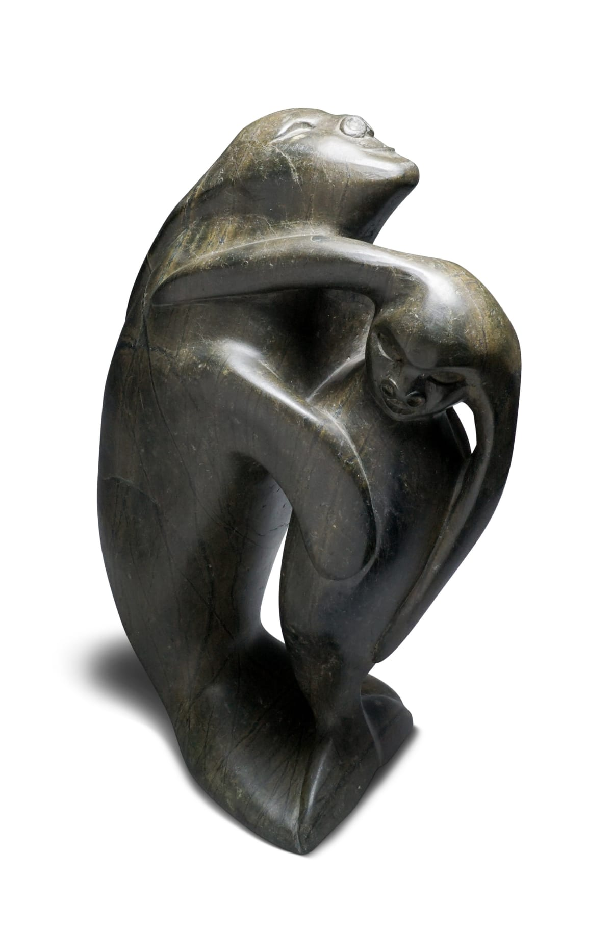 LOT 2 OSUITOK IPEELEE, R.C.A. (1923-2005) KINNGAIT (CAPE DORSET) Swimming Sedna With Her Child, c. 1970s stone, 16 x 10 x 6 in (40.6 x 25.4 x 15.2 cm) ESTIMATE: $2,500 — $3,500