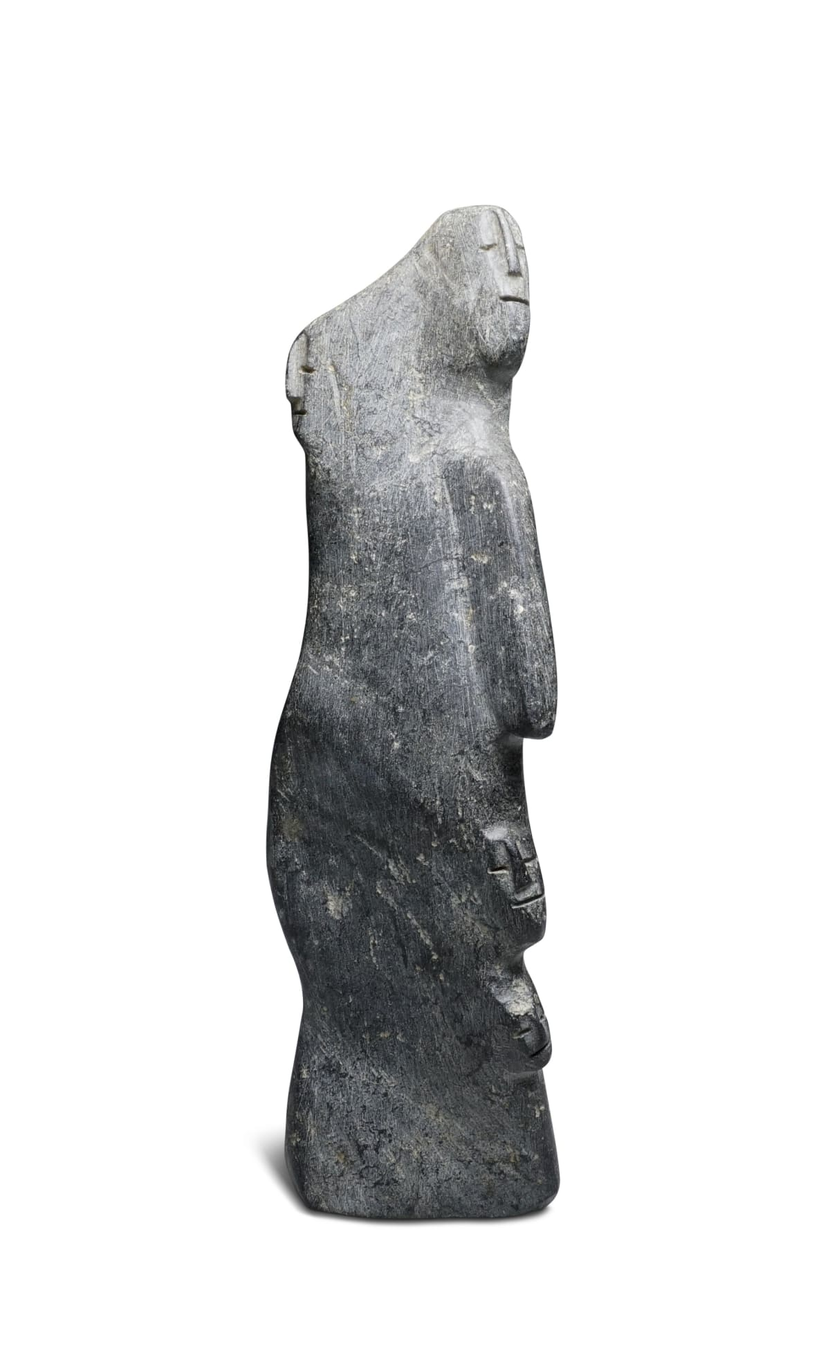 Lot 7A LUCY TASSEOR TUTSWEETOK (1934-2012) ARVIAT (ESKIMO POINT) Family, early 1980s stone, 8 1/4 x 2 1/2 x 3 3/4 in (21 x 6.3 x 9.5 cm) ESTIMATE: $1,000 - $1,500