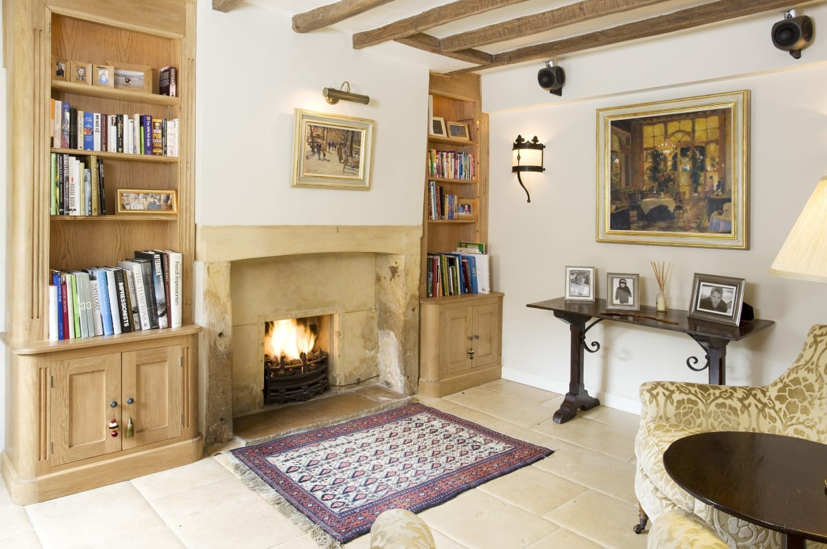 Original paintings by Bruce Yardley in this Cotswold cottage entrance hall