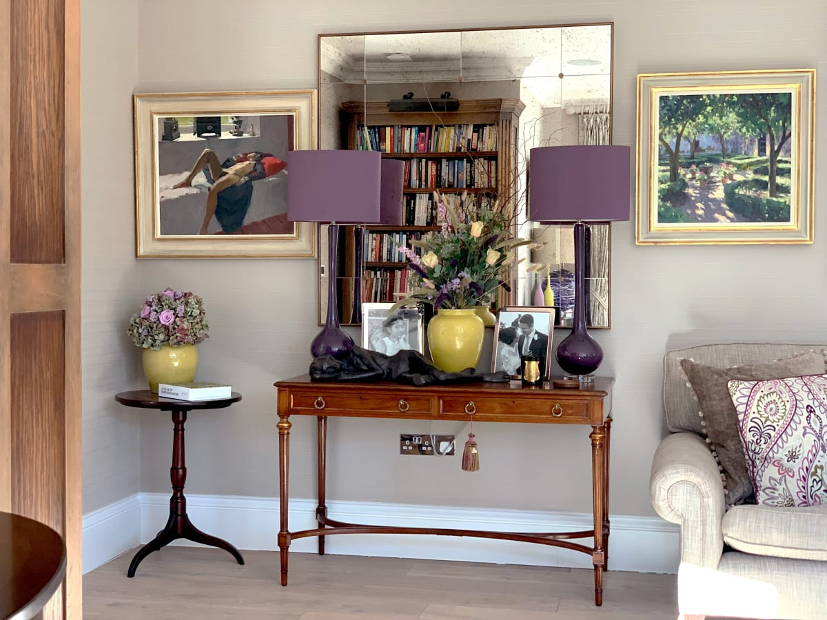 A cohesive interior with plenty of interest and lifted by these two original oil paintings by Ken Howard and Edward Noott
