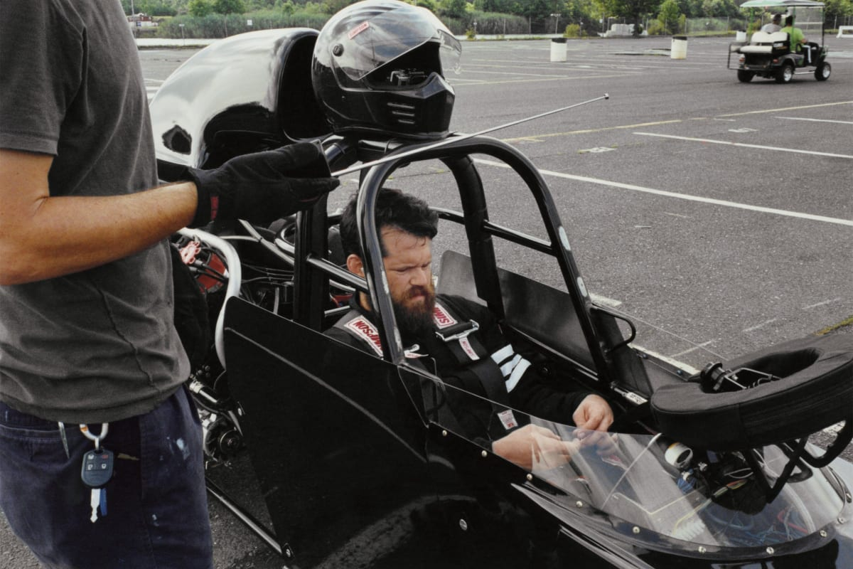 The artist Matthew Day Jackson in the Super Comp dragster that he races regularly in New Jersey. Credit: Sean Donnola