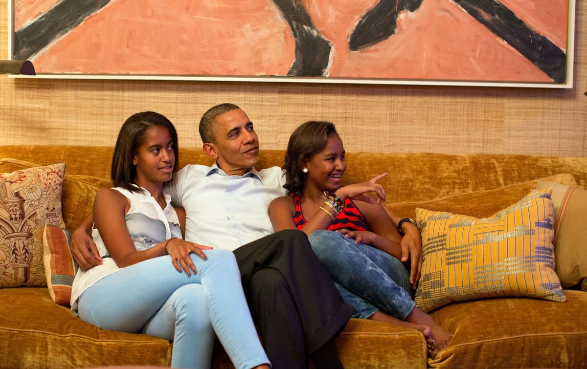 President Obama and his daughters, Malia (left) and Sasha, are seated in the Treaty Room under a painting by Susan Rothenberg.