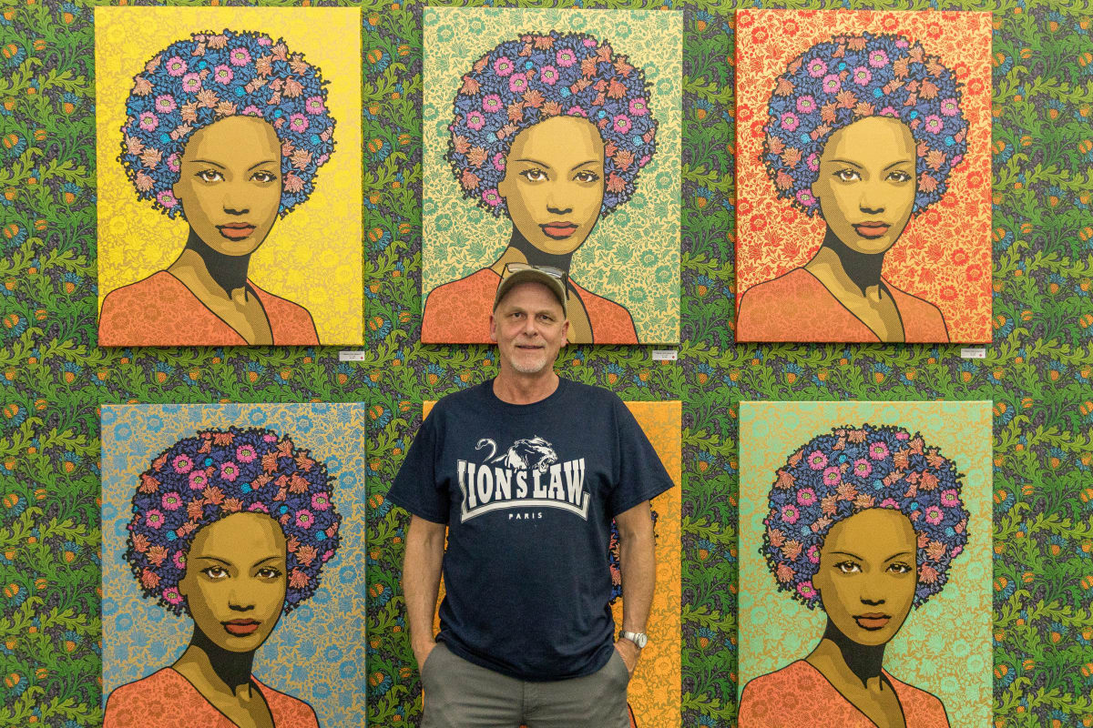 Portrait of artist Chuck Sperry in front of his work