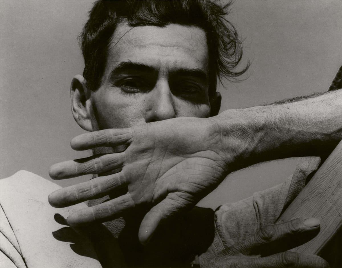 portrait of cotton picker covering face with back of his hand
