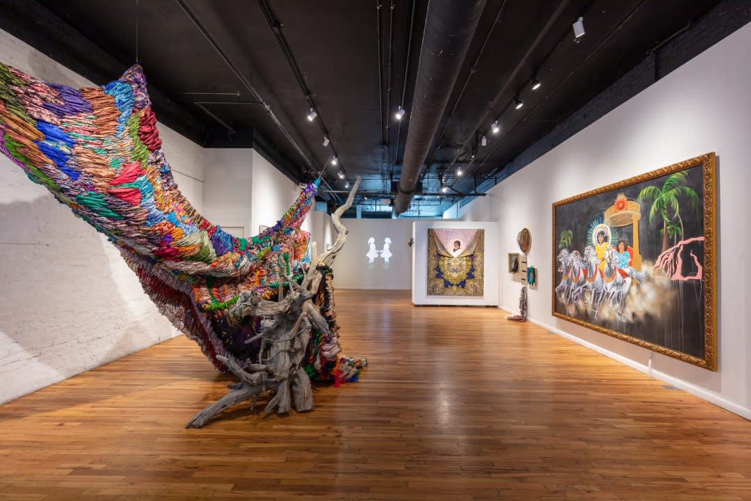 """Suchitra Mattai works with found and collected objects, such as the hundreds of vintage saris used in the piece, """"Breathing Room,"""" which also incorporate driftwood and table legs. (Photo by Wes Magyar, provided by K Contemporary)"""