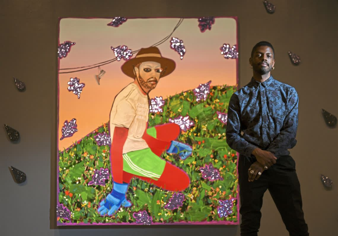 Devan Shimoyama in front of one of his paintings in Cry, Baby, at the Warhol Museum. Photo: Steve Mellon/Post-Gazette