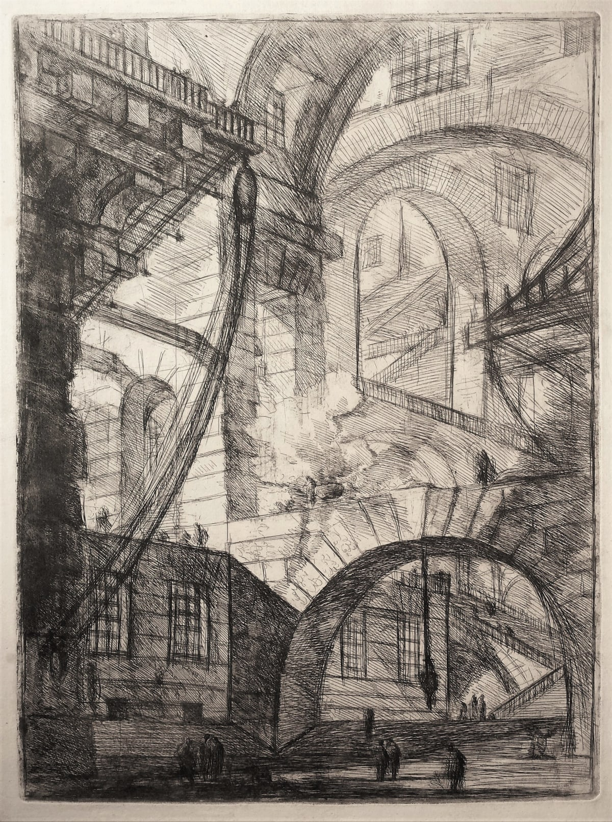 Giovanni Battista Piranesi, Perspective of Arches, with a Smoking Fire, 1749 Etching, engraving, sulphur tint or open bite, burnishing 54 x 40 cm Robison 32, 1st state (of 7), 1st edition (of 6) (1749-1760). Watermark: fleur-de-lys in a single circle. Plate VI of 'Carceri d'Invenzione' ['Imaginary prisons'] or 'Invenzioni capric. di carceri' ['Fanciful Images of Prisons'].