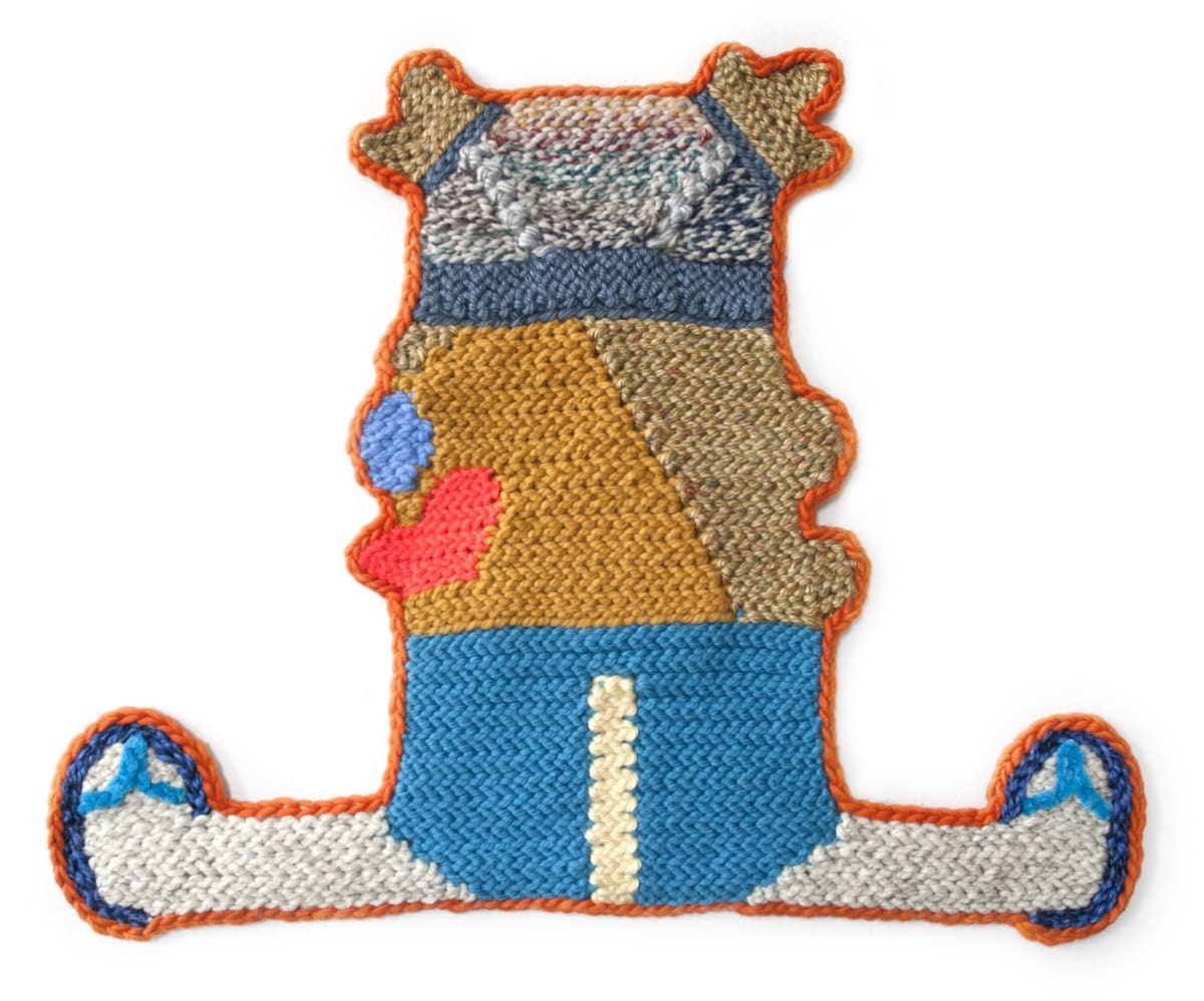 """Caroline Wells Chandler's """"Jamey"""" done with hand crocheted assorted fibers in shades of blue, red, brown, orange, tan and gray. The work resembles an anthropomorphic bear sitting down wearing sandals."""