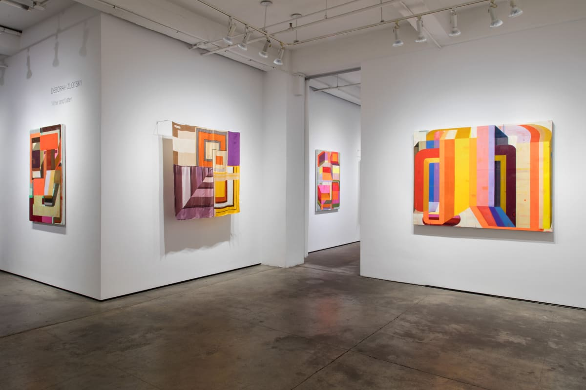 """Installation shot of four pieces of art by Deborah Zlotsky. From left to right, they are """"Lady Marmalade"""", """"For sure 100%"""", """"Detours and delays"""" and """"I could drink a case of you"""". """"For sure 100%"""" is made from vintage scarves. The rest are oil on canvas."""