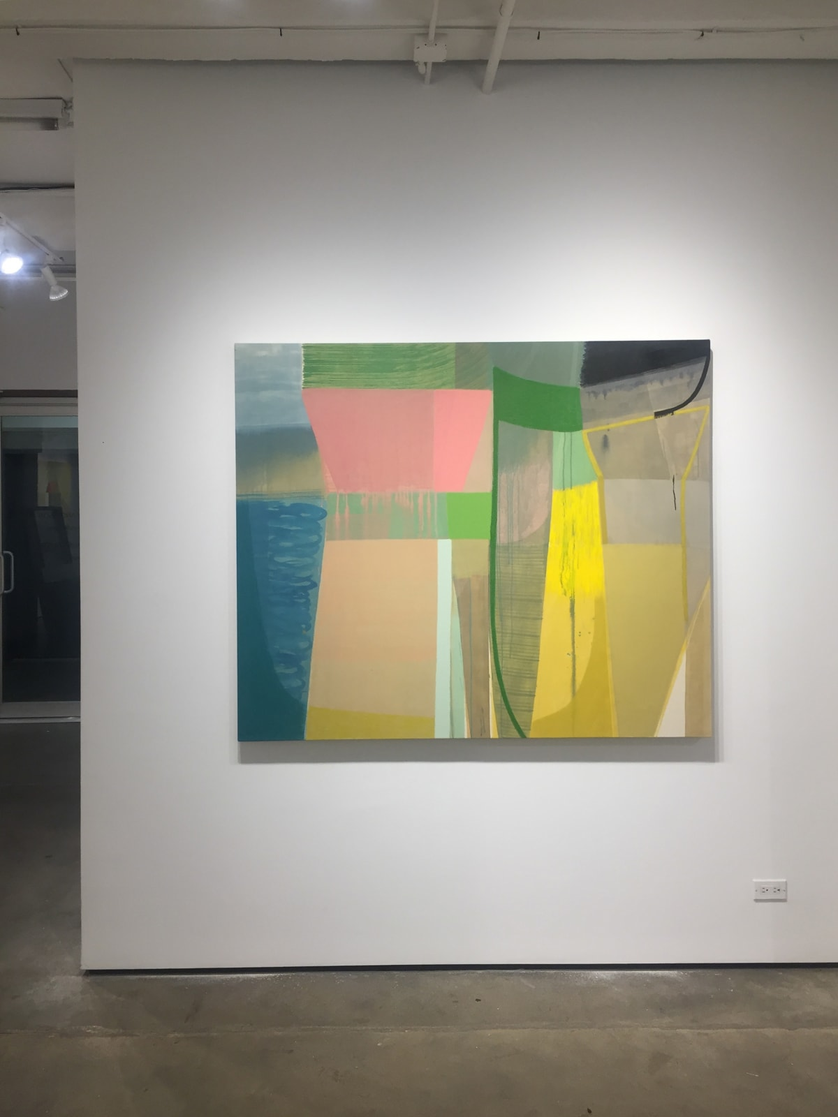 """Installation shot of Ky Anderson's """"Forest"""" painting. An abstract pigment, acrylic and oil painting on canvas in shades of green, blue, pink, yellow, tan, gray and black."""