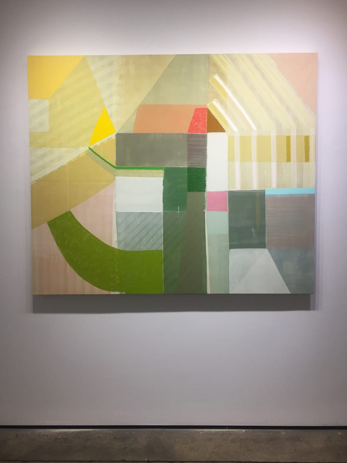 """Installation shot of Ky Anderson's """"Wind"""" painting on canvas. The painting was done in pigment, oil and acrylic paint in shades of green, yellow, tan, red, blue and pink."""