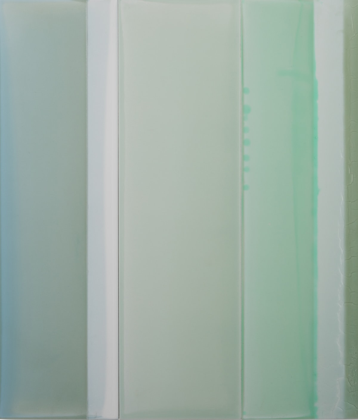 """Susan English's """"Thirds No. 1"""" done with tinted polymer on panel. This artwork is a simple vertical design done in shades of green, though it looks more muted. If the work was seen from a viewer's perspective, it resembles wall or floor tiles."""