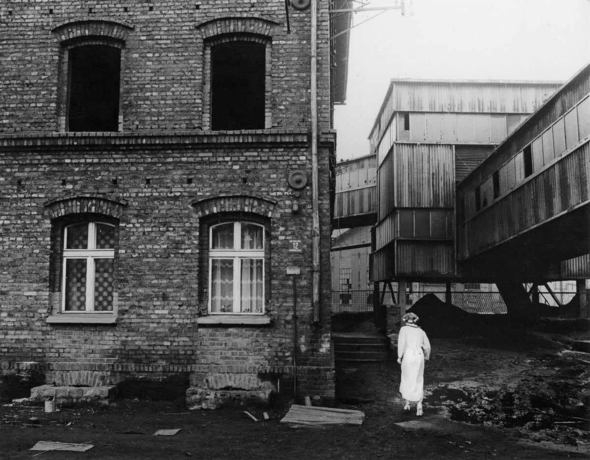 Michal Cala, 'A woman in curls'/ Housing estate next to Wieczorek coalmine, Katowice - Janow, Poland, 1985