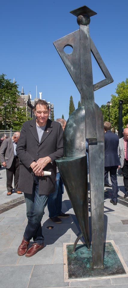 Paul Dibble with his new sculpture, 'Pathways', at the University of Otago