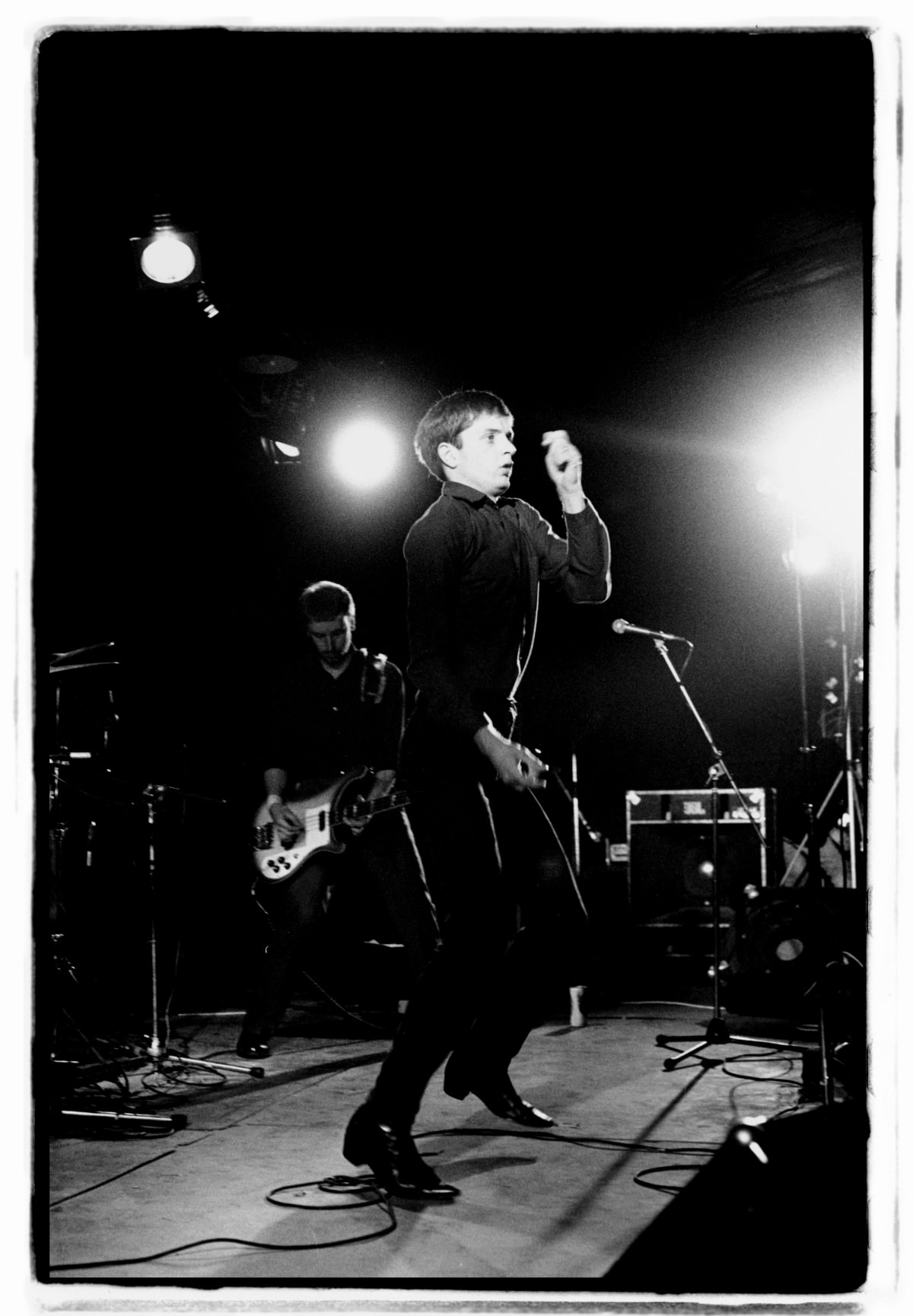 Kevin Cummins 9.Peter Hook and Ian Curtis, Joy Division. Fac 15: Zoo meets Factory Half Way. Leigh Festival, Lancashire 27 August 1979, 2006 Gelatin-silver print. Edition of 75 40.6 x 50.8 cm 16 x 20 in Edition of 75