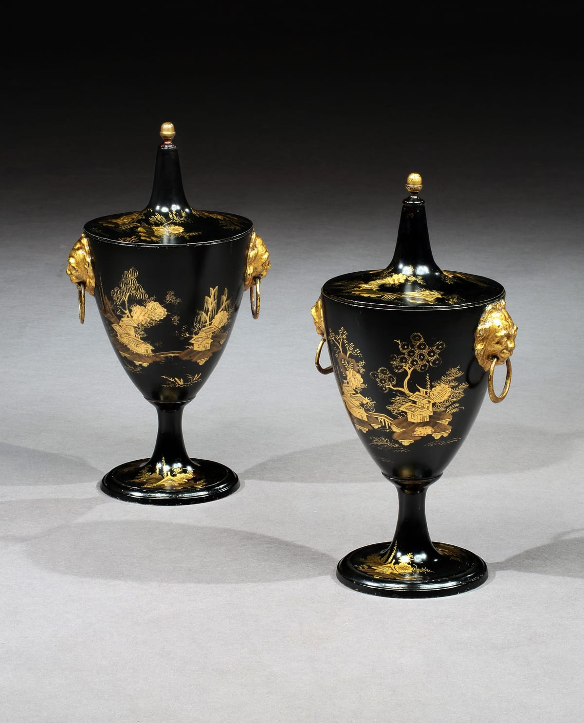 A PAIR OF GEORGE III JAPANNED CHESTNUT URNS, ENGLISH, CIRCA 1800