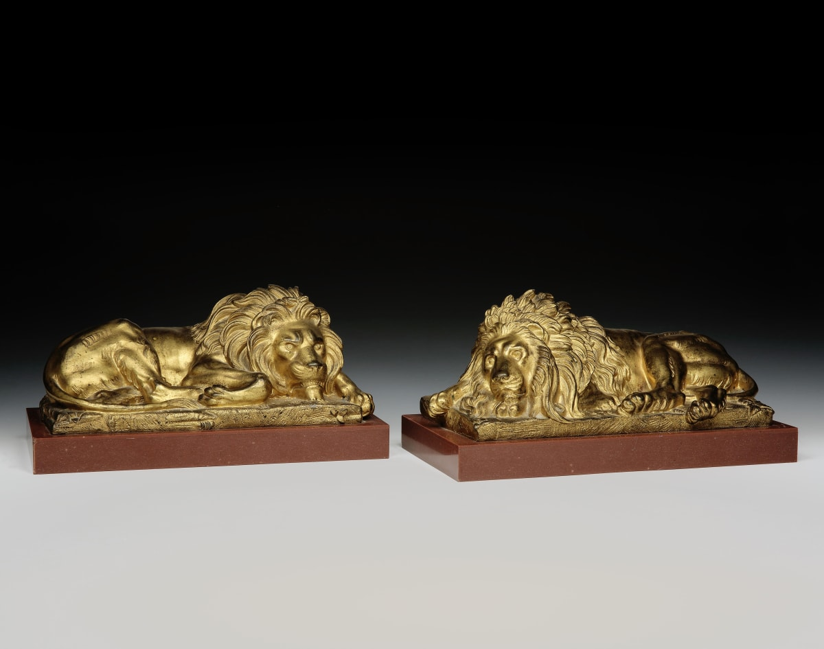 A PAIR OF EARLY 19TH CENTURY BRONZE LIONS, ITALIAN, CIRCA 1840