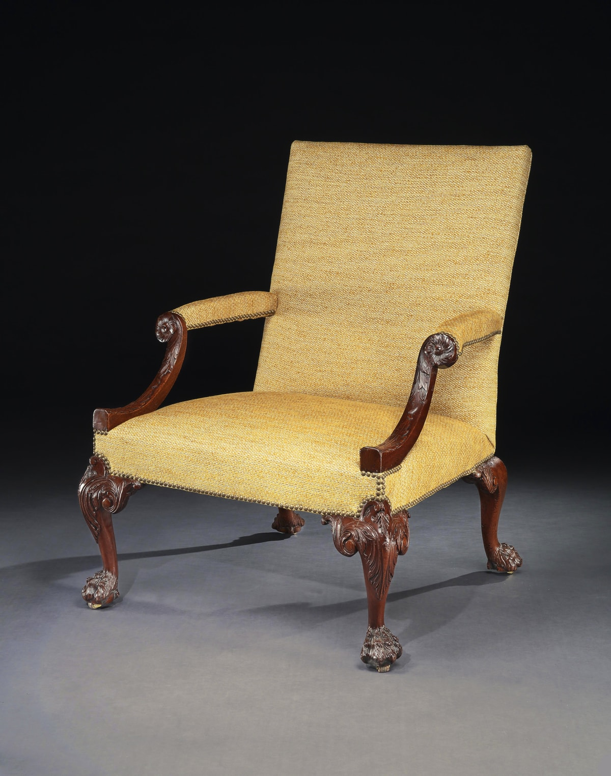 A GEORGE II MAHOGANY LIBRARY CHAIR, ENGLISH, CIRCA 1755