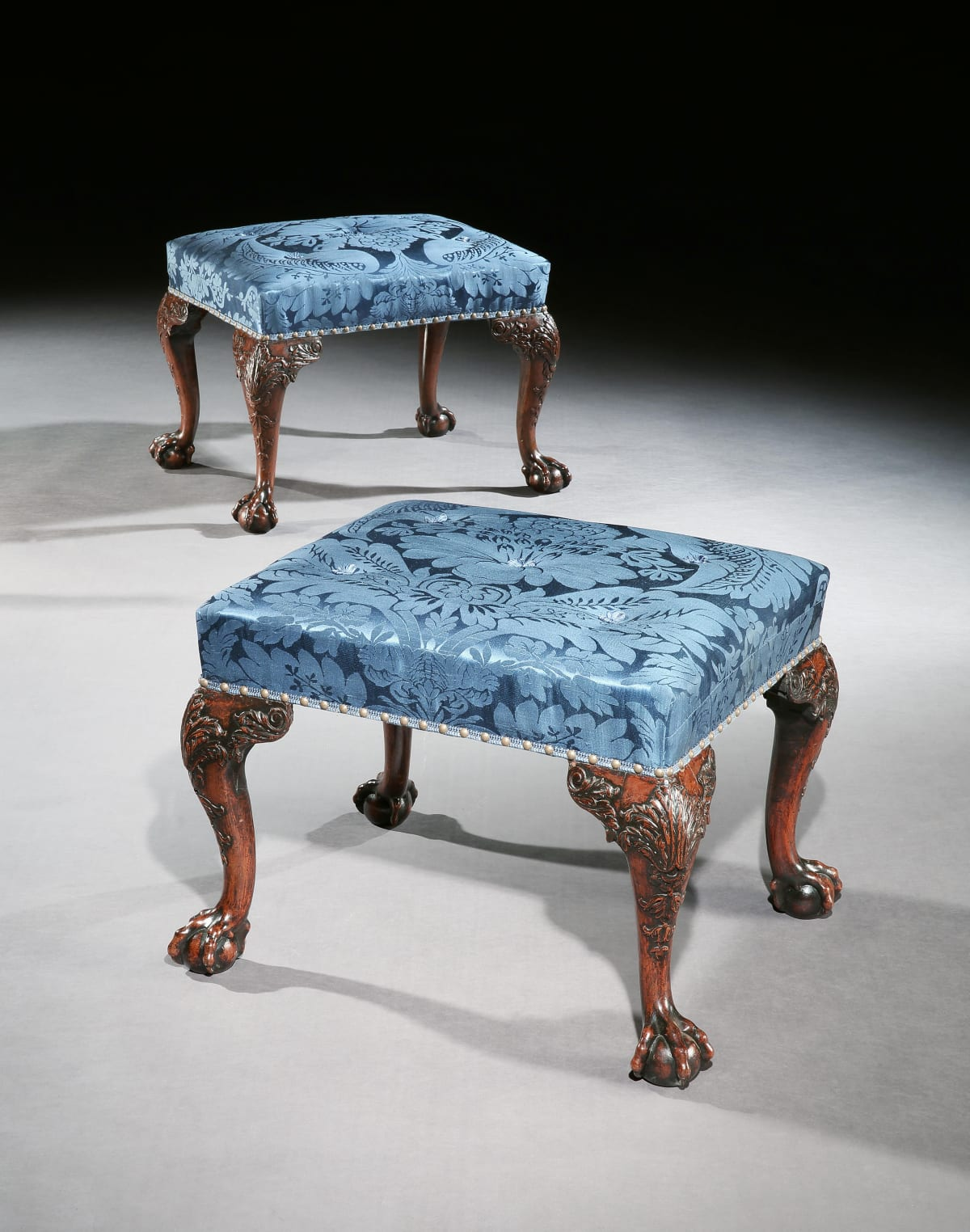 A PAIR OF GEORGE III CHIPPENDALE MAHOGANY STOOLS, English circa 1770