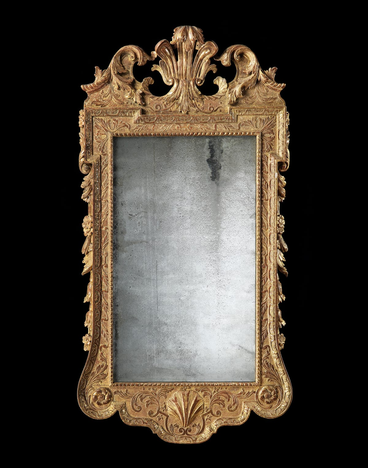 A GEORGE I CARVED AND GILDED MIRROR, ENGLISH, CIRCA 1735