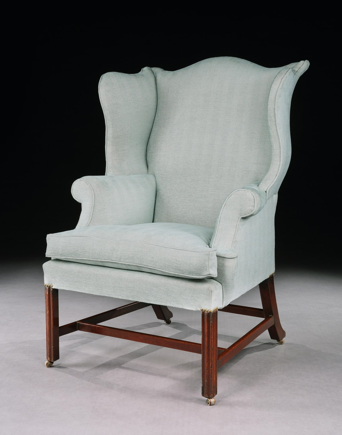A GEORGE III MAHOGANY WING CHAIR, ENGLISH CIRCA, 1770