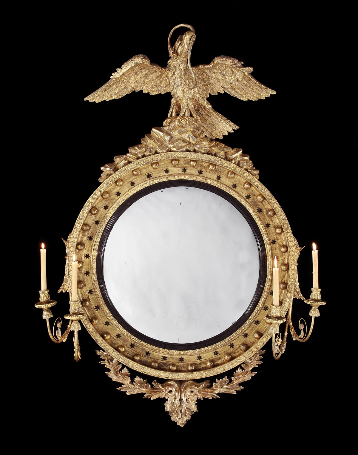 A HUGE REGENCY CARVED AND GILDED CONVEX MIRROR, English, circa 1810