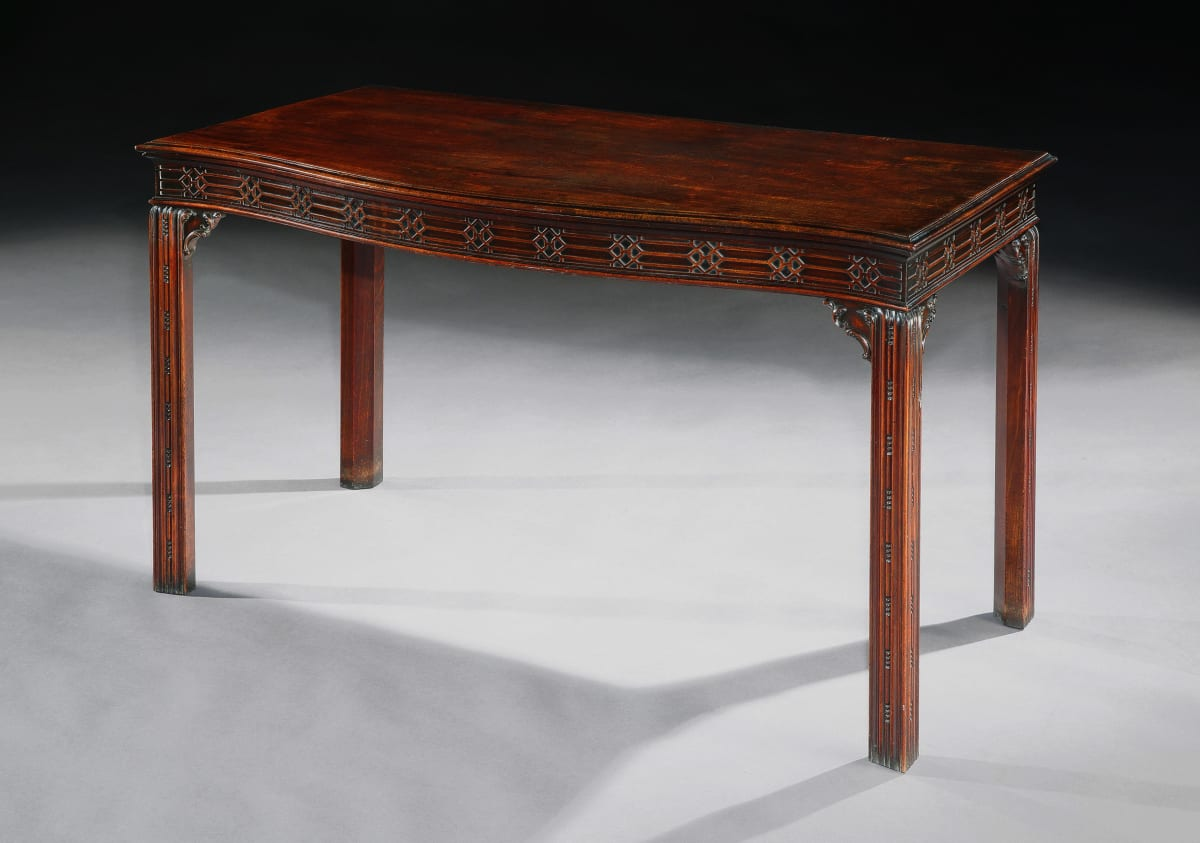 A GEORGE III SERPENTINE MAHOGANY SERVING TABLE, English, Circa 1765