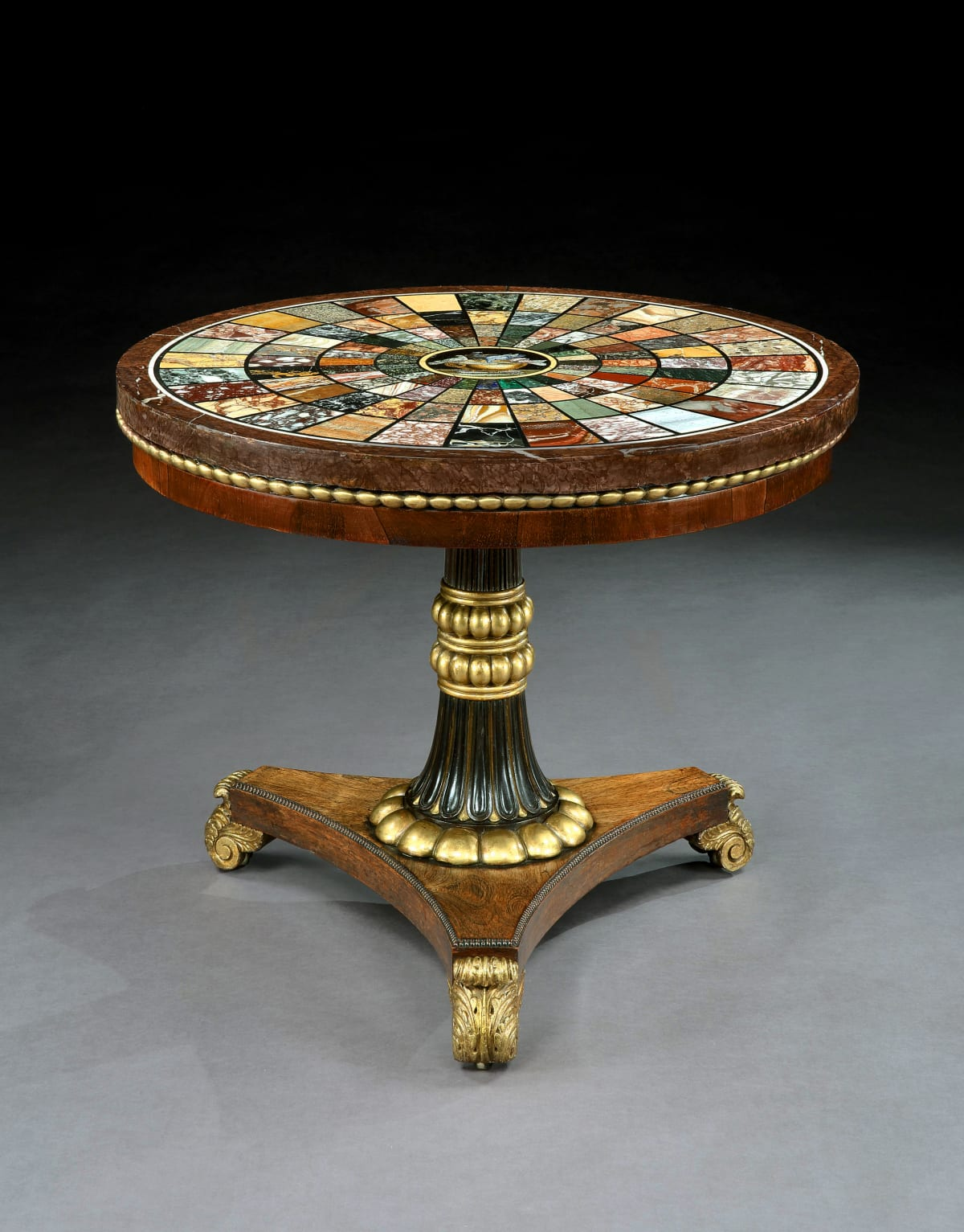 A REGENCY ROSEWOOD CARVED AND GILDED CENTRE TABLE WITH SPECIMAN MARBLE TOP, English, circa 1810