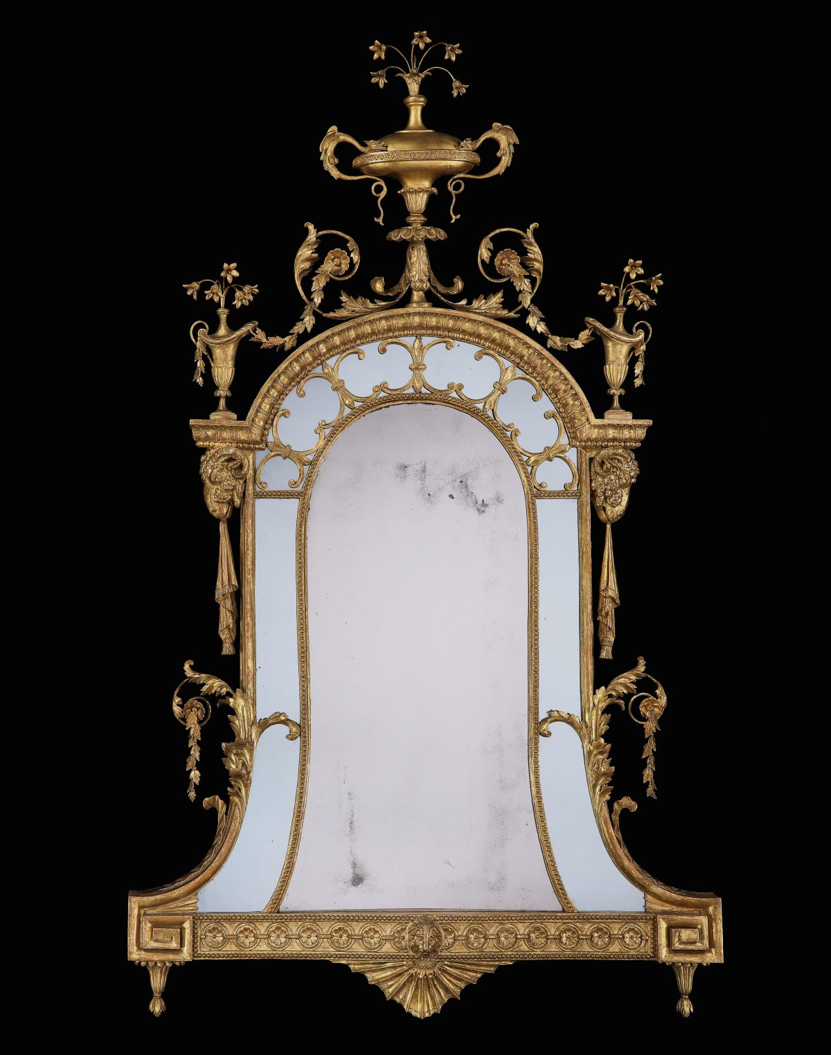 The H.J.Joel Mirror. A GEORGE III CARVED AND GILDED MIRROR, ENGLISH CIRCA 1780