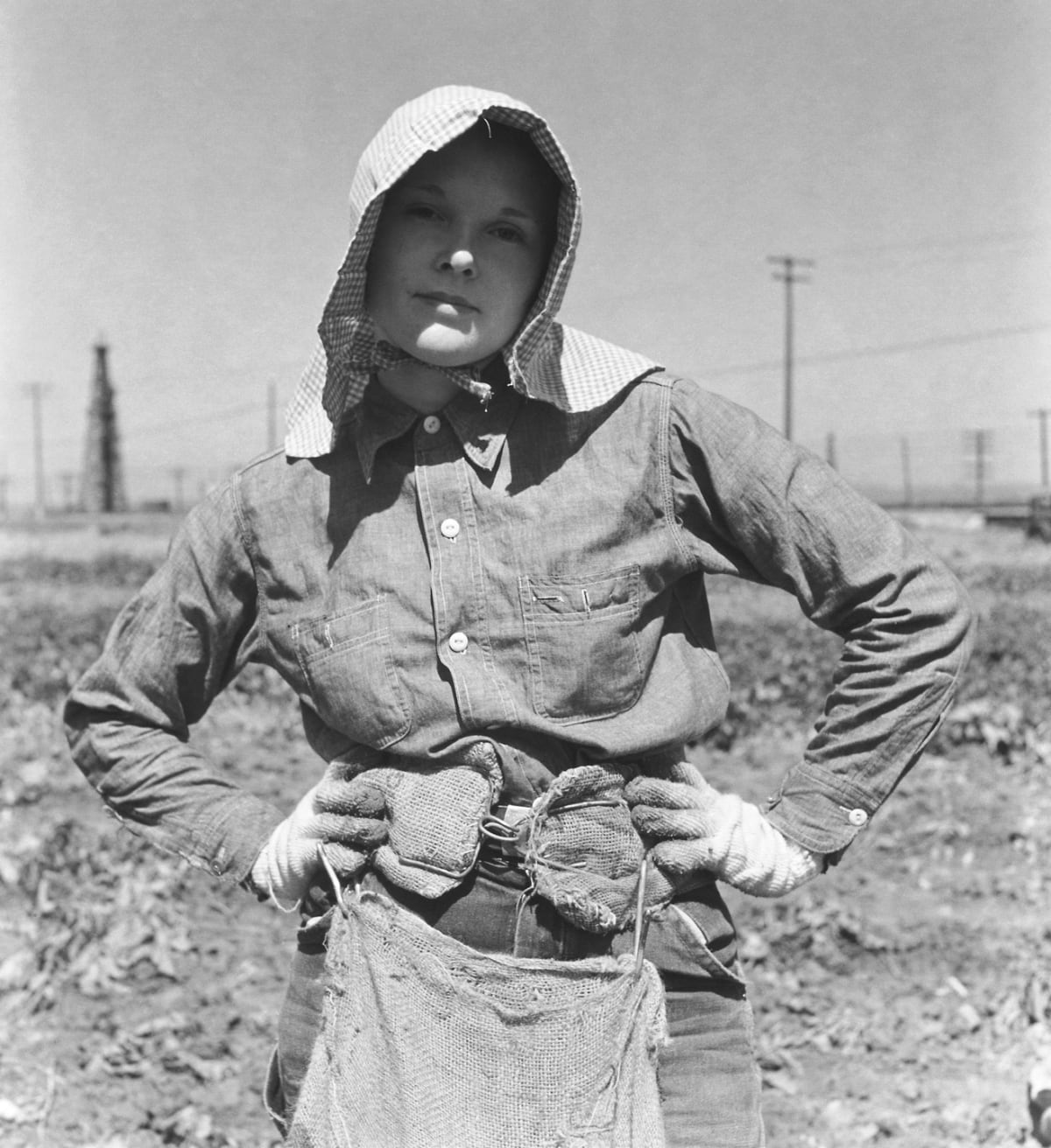 Potato Field Madonna, Kern County, California, 1940 Ron was hired by Dorothea Lange to drive her throughout California as she photographed the conditions of migrant workers. Ron also took the opportunity to photograph as well, during these trips. Here he photographed a young woman that was just about the same age he was at that time.