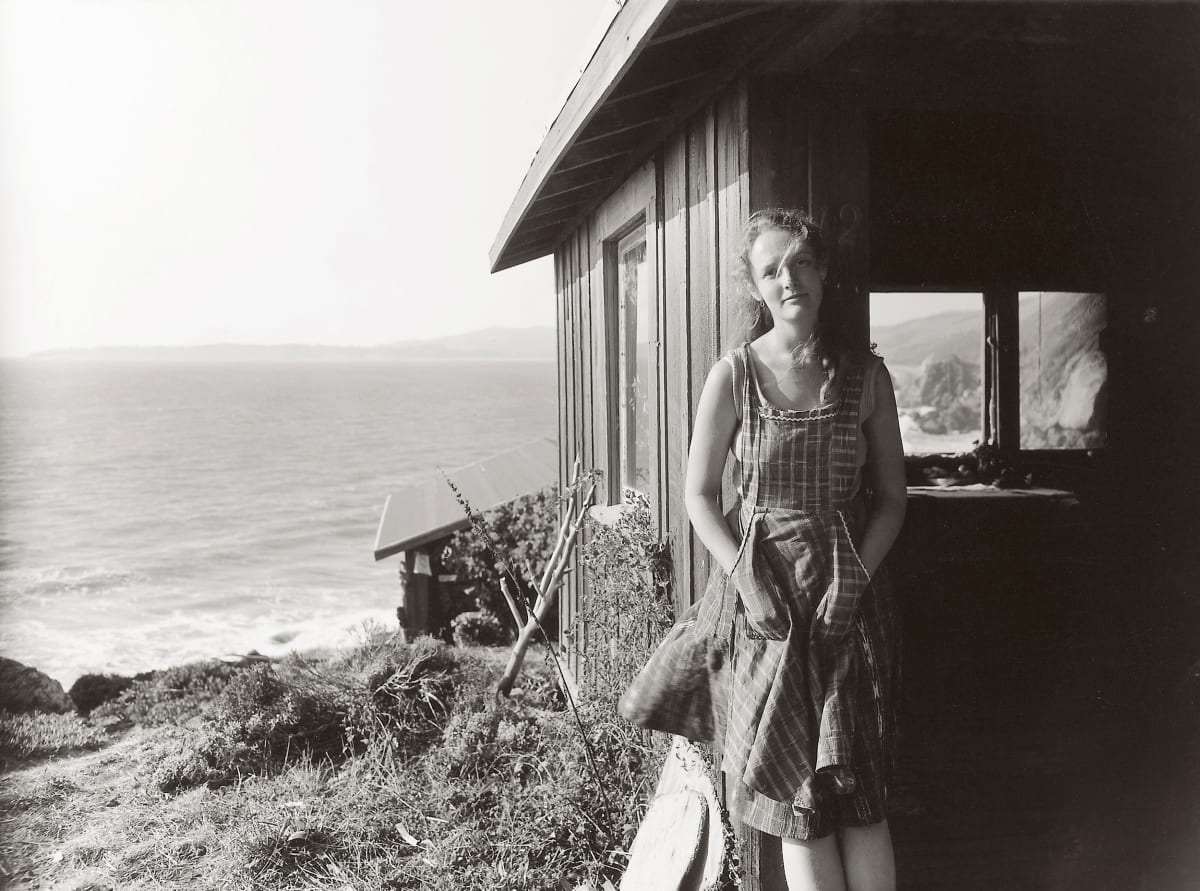 Annie at Steep Ravine, Marin County, California, 1972 This photograph was taken at Dorothea Lange's cabin on the cliffs overlooking the Pacific Ocean. Steep Ravine was one of Dorothea Lange's favorite places; Dorothea and Paul Taylor rented this cabin for decades, returning often to spend a few hours or a few days enjoying life by the ocean. The cabin was simple - cold running water and no electricity; a place which invited reflection and attention to life at the moment. Annie was a friend of the family, staying at Steep Ravine at the time.