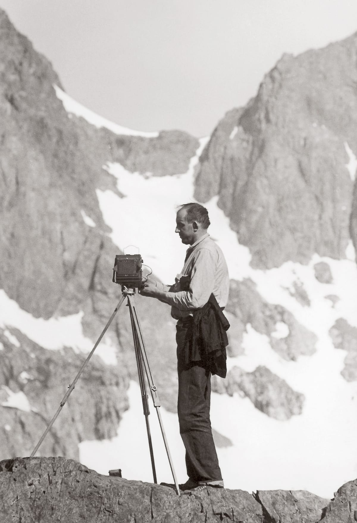 Ansel Adams in the Sierra, late 1930s When Ron worked for Ansel Adams, they would go into the high country of the Sierra Nevada to photograph. In this shot, Ron captured Ansel on the moutain, which Ron referred to Lightning Ridge. A moment later, they descended the mountain quickly as a storm gathered momentum and was moving in.