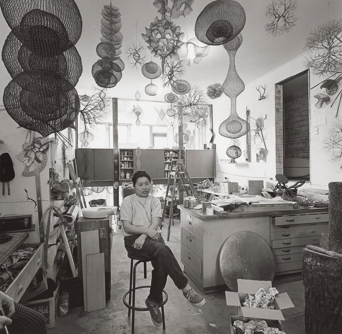Ruth Asawa in Her Studio, San Francisco, 1969 Ruth Asawa and Ron were good friends, living across the Bay from each other in the San Francisco Bay Area. this photograph of Ruth was taken in her studio in San Francisco.