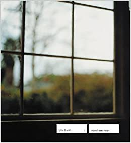 """Exhibition catalogue for Uta Barth exhibition """"nowhere near"""". Blurred photo of a wooden window pane looking out on a garden and bare trees in the distance."""